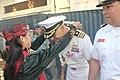 U.S. Navy USS VANDEGRIFT's Commanding Officer CDR Brandon Bryan is greeted by Rainbow Dancers.jpg