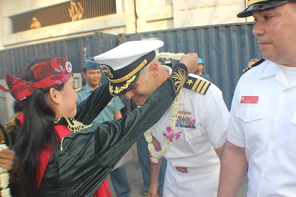 U.S. Navy USS VANDEGRIFT's Commanding Officer CDR Brandon Bryan is greeted by Rainbow Dancers