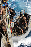 U.S. Sailors with the visit, board, search and seizure team embarked aboard guided missile cruiser USS San Jacinto (CG 56) come on board after completing an investigation of a dhow May 24, 2010, in the Gulf 100524-N-EF447-258.jpg