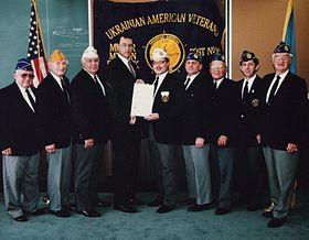 Members of the Ukrainian American Veterans meet with New Jersey Commissioner of Veteran Affiars Michael Warner after the presentation ceremony for Ukrainian Independence Day. From left: Alex Zanko, Michael Wengryn, John Tymash, Commissioner Mike Warner, Commander George A. Miziuk, Robert Iwanczewsky, John Pawlow, Bernard Krawczuk and John Zakanycz. Photo Credit: Roman M. Martyniuk