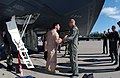 """US Air Force (USAF) Major (MAJ) Andrew Gebara (left), Mission Commander on the B-2 """"Spirit"""" bomber, greeted by USAF Colonel (COL) Floyd Carpenter, Commander, 40th Air Expeditionary - DPLA - 0cc8ddbcaa1c62b73be786a38927bf86.jpeg"""