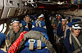 US Navy 020725-N-5319A-574 Actor Bruce Willis and film crew prepare for a C-2 flight.jpg