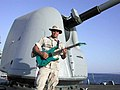 US Navy 020812-N-0625X-001 Chief plays the guitar after an underway replenishment.jpg