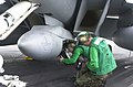 US Navy 030113-N-2385R-001 installing the data storage unit into the Shared Reconnaissance Pod.jpg