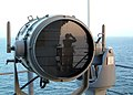 US Navy 030228-N-2321D-001 Seaman Boris V. Itkis is reflected in a signal light as he stands watch on the signal bridge aboard USS Boxer (LHD 4).jpg