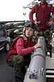 US Navy 030413-N-0413R-001 Aviation Ordnanceman Airman Kelly Poelstra from Bellflower, Calif., prepares to load an AIM-20.jpg