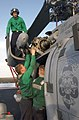 US Navy 030503-N-4953E-006 Aviation Machinist's Mates perform preventative maintenance on an SH-60 Seahawk helicopter on the flight deck aboard USS Harry S. Truman (CVN 75).jpg