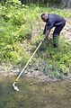 US Navy 030718-N-6470V-001 Melvin Murphy is dipping for mosquito larvae as part of a base wide effort to help eliminate mosquitoes and fight against the West Nile virus.jpg