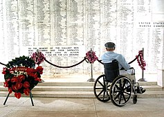 US Navy 040120-N-0879R-009 Pearl Harbor survivor Bill Johnson stares at the list of names inscribed in the USS Arizona Memorial.jpg