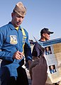 US Navy 040320-N-6060O-378 Lt. Craig Olson, a pilot assigned to the U.S. Navy flight demonstration team, the Blue Angels, signs autographs for excited fans after the annual air show on board Naval Air Station Lemoore, Calif.jpg
