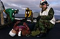 US Navy 040621-N-0684R-045 Hospital Corpsman 2nd Class John Wierzbinski informs the Flight Deck Officer of a casualty situation during a mass casualty drill.jpg