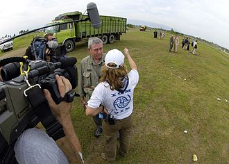 CBS Evening News - Rather interviews an IOM worker at the Sultan Iskandar Muda Air Force Base in Indonesia on January 3, 2005, following the 2004 Indian Ocean earthquake and tsunami.