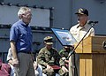 US Navy 050203-N-0499M-091 Commander Carrier Strike Group Nine (CSG-9), Rear Adm. Doug Crowder presents the U.S. Ambassador to Indonesia, the Honorable Lynn Pascoe, with a framed photo commemorating the humanitarian relief effo.jpg