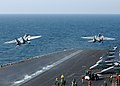 US Navy 050315-N-5345W-163 Two F-14B Tomcats launch in tandem from the waist and bow steam-powered catapults aboard the Nimitz-class aircraft carrier USS Harry S. Truman (CVN 75).jpg