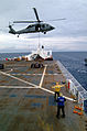 US Navy 050408-N-0357S-027 A Landing Signal Enlisted Sailor guides an MH-60S Seahawk helicopter, assigned to Helicopter Combat Support Squadron Five (HC-5), during a vertical replenishmen.jpg
