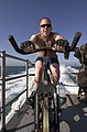 US Navy 050507-N-3289C-028 Gunners Mate 2nd Class Matthew Maple, from Pittsburgh, Pa., takes time out to stay physically fit by training on a stationary bike aboard the costal patrol ship USS Sirocco (PC 6).jpg