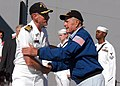 US Navy 050703-N-6214F-043 USS Iwo Jima (LHD 7) Commanding Officer, Capt. Richard S. Callas greets former U.S. President George H. Bush as he prepares to come aboard the amphibious assault ship.jpg