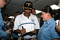 US Navy 050805-N-4702D-003 The head coach of the Indianapolis Colts football team Tony Dungy signs an autograph for Information Systems Technician 2nd Class Shannanan Arney aboard the command ship.jpg