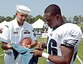 US Navy 050811-N-4729H-171 Storekeeper 1st Class Washington Jaramillo assigned to Navy Recruiting District Philadelphia gets an autograph from Philadelphia Eagles cornerback Lito Sheppard.jpg
