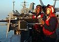 US Navy 051204-N-0685C-007 Aviation Boatswain's Mate Ramon Stanton and Airman Marcus Glenn stand the starboard .50 caliber machine gun watch aboard the Nimitz-class aircraft carrier USS Theodore Roosevelt (CVN 71).jpg