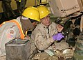 US Navy 060117-N-3607D-001 Aviation Electronics Technician 2nd Class James Smith assigned to Navy Customs Battalion Papa, shows Sgt. Perry Saunders, of 632nd Maintenance Company the areas they need to clean.jpg