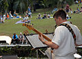 US Navy 060311-N-8946D-058 Musician 2nd Class Richard Bruns assigned to the U.S. 7th Fleet Band plays bass guitar to a captive audience during a performance for the local community.jpg