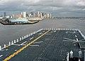 US Navy 060628-N-2382W-108 Sailors aboard the amphibious assault ship USS Kearsarge (LHD 3) man the rails while entering Boston Harbor.jpg
