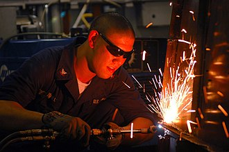 Hull maintenance technician - Image: US Navy 061027 N 8119R 159 Hull Maintenance Technician 3rd Class Jeremy Hanel uses a cutting torch to cut apart old shelving aboard the nuclear powered aircraft carrier USS Nimitz (CVN 68)