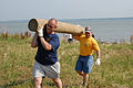 US Navy 070606-N-6724S-027 Aviation Support Equipment Technician 1st Class Manfred Gooden (left) and Senior Chief Machinist's Mate Kenneth Cowen carry away a piling.jpg
