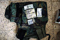 US Navy 070709-N-5555T-002 Suspected Iranian money and a flack jacket found in the home of a local Iraqi man who was detained by the 1st Battalion, 30th Infantry Regiment in the Arab Jabour region of Iraq is shown.jpg