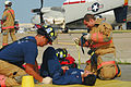 US Navy 070724-N-0924R-116 Firemen from Navy Mid-Atlantic Region Fire and Rescue Team treat the wounds of Sailors posing as victims of a simulated C-2A Greyhound plane crash during a crash, fire and rescue drill held on Naval S.jpg