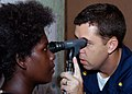 US Navy 070823-N-9195K-077 Lt. Cmdr. Matt Behil uses a ophthalmoscope to check a local woman's eyes during a medical civic action program at Voza Medical Clinic in support of Pacific Partnership.jpg