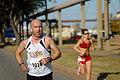 US Navy 071014-N-5330L-044 Participants pass mile 11 in the Naval Station Norfolk Fleet Week Half Marathon.jpg