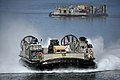 US Navy 080709-N-8135W-079 A landing craft air cushion delivers equipment to the amphibious assault ship USS Bonhomme Richard (LHD 6) during the Rim of the Pacific (RIMPAC) exercise.jpg
