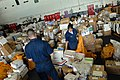 US Navy 080710-N-4995K-209 Sailors aboard the Nimitz-class aircraft carrier USS Ronald Reagan (CVN 76) sort through mail in the hangar bay.jpg