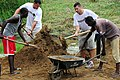 US Navy 080912-N-7526R-300 Lt. Argus Cunningham and Cmdr. Steve Hargatai help move dirt to fill in a flooded courtyard.jpg
