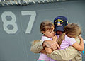 US Navy 080912-N-9985W-005 Interior Communications Electrician Chief Petty Officer Joseph Stevenson hugs his daughters goodbye before he deploys aboard the guided-missile destroyer USS Mason (DDG 87).jpg