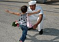 US Navy 081005-N-1522S-015 onar Technician 2nd Class David Boswell is welcomed home by his daughter after his return home aboard the guided-missile frigate USS McInerney (FFG 8) from a six-month deployment.jpg