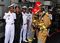 US Navy 081014-N-2013O-005 Sailors demonstrate proper hose handling technique to sailors from the Royal Cambodian navy.jpg