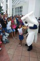 US Navy 090427-N-6259S-098 Cavity Calvin the Calcium Cleaner greets children as they wait in line to be seen by medical professionals from the Military Sealift Command Hospital ship USNS Comfort (T-AH 20) in Santo Domingo.jpg