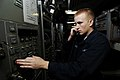 US Navy 091021-N-3038W-016 Information Systems Technician Seaman Dwight Ogle inspects the black audio switch in the combat systems message center.jpg