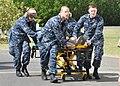 US Navy 100113-N-8241M-103 Navy hospital staff members rush an American U.S. Embassy worker into the U.S. Naval Hospital at Guantanamo Bay, Cuba.jpg