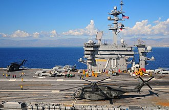 USS Carl Vinson - Carl Vinson off Haiti, to aid in earthquake relief; the ship carried 19 helicopters specially for this mission.