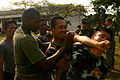 US Navy 100205-M-4689B-036 Marine Corps Lance Cpl. Cornelius Greer instructs a Royal Thai Marine how to properly apply a non-lethal takedown move during a subject-matter expert exchange.jpg