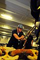 US Navy 100226-N-2953W-378 Boatswain's Mate 2nd Class Brandon Terry reapplies a pelican hook to the anchor chain in the forecastle of the aircraft carrier USS Carl Vinson (CVN 70).jpg