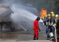 US Navy 100518-N-9520G-002 Sailors from various commands combat a simulated flight deck fire during a flight deck fire fighting course at the Center for Naval Aviation Technical Training Unit Whidbey Island.jpg