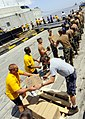 US Navy 100905-N-9643W-175 Sailors, Marines, Airmen and contracted mariners unload 18 pallets of Project Handclasp humanitarian aid supplies to a pier in Guyana.jpg