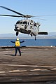 US Navy 101212-N-3659B-078 Boatswain's Mate 3rd Class Leshea Isom, from Newark, N.J., directs an MH-60S Sea Hawk helicopter assigned to the Wildcar.jpg