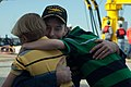 US Navy 110405-N-FG395-060 Cmdr. Kevin Byrne hugs two of his sons at the submarine's homecoming at Naval Submarine Base Kings Bay.jpg