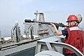 US Navy 110514-N-GW695-016 Gunner's Mate 3rd Class Amber Cooper prepares to fire a shot-line from the amphibious transport dock ship USS Green Bay.jpg